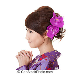 Japaneses woman praying, young Asian beauty dress in yukata