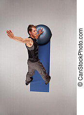 Fit man exercising with half-ball - Overhead view of man...