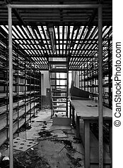 empty shelves in storage room - Rows of empty shelves in...