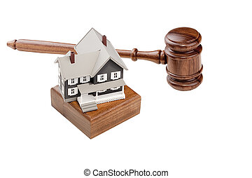 House Auction - Gavel and house model isolated on a white...
