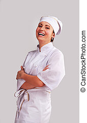 Cute cook girl - Young woman in white chef dress with hat