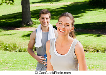 Sporty couple in the park