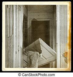 vintage photo of ghost in haunted hallway