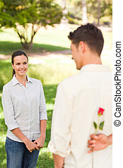 Man offering a rose to his girlfriend
