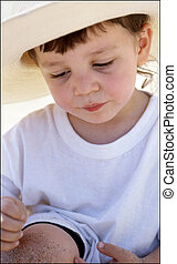 Young Boy in Straw Hat