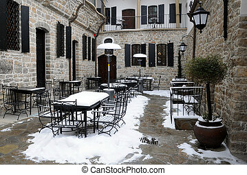 Empty Courtyard Restaurant in the Winter - Empty courtyard...