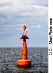 Buoy on the water - The red buoy in the Baltic Sea.