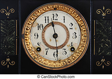 antique clock - old antique clock face from black cast iron...