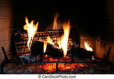 fireplace fire - a fire burns in a fireplace with red coals