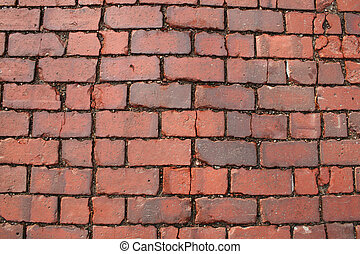 red brick road background - surface of an old red brick road...