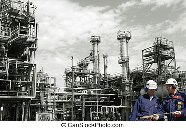 oil workers and fuel installation - two oil-workers,...
