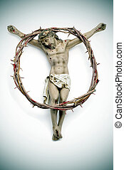 Jesus Christ and bloody crown of thorns - a figure of Jesus...