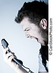 Man shouting on the phone - Angry young man shouting on the...