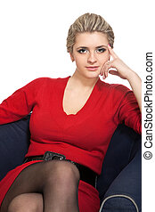 Woman sitting on arm chair