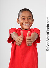 Happy boy gives the thumbs up - Happy young boy smiling and...