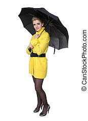 Woman in yellow coat, shoes and umbrella