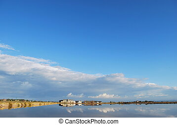Scenic saltern, cloudy sky and water reflections, Cervia,...
