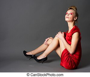 Sexy slim woman in red dress - Young fashionable model in...
