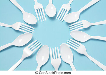 Plastic Forks and Knives on Blue Background