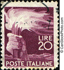 hand held torch - ITALY - CIRCA 1948: A stamp printed in...