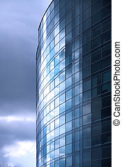 Modern office building exterior. Cloudy. Blue tint.