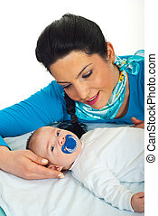 Mother talking with her newborn baby - Happy mother talking...