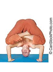 Man doing yoga exercise isolated on white