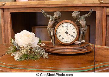 Interior Mantel Clock - Interior wooden clock with two boys...