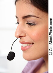 Profile of receptionist and headset - Close up headshot of...