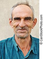 Elderly bald man, natural smile and positive grimace