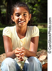 Smiling girl in golden sunshine - School girl age nine with...