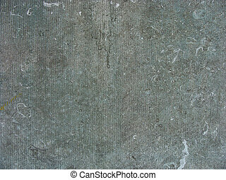 blue colored stone slab from a pedestal underneath a bronze...