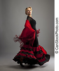 Beauty woman dance flamenco in black and red