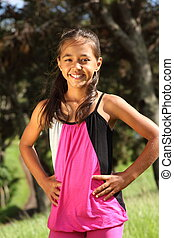 Cheerful young girl in the park - Young school girl, 10...