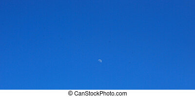 Half moon. - Half moon in blue sky.