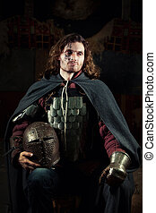 Medieval knight - Powerful knight in the armor with the...