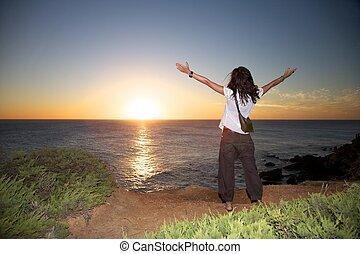 woman see off sun - Conil coastline at Cadiz Andalusia in...