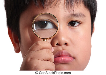 Child with magnifying glass