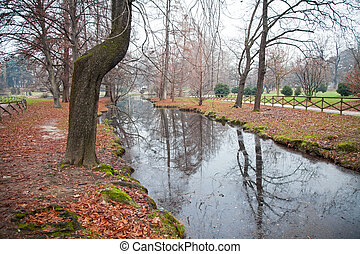Autumn park with river in Milano, Italy