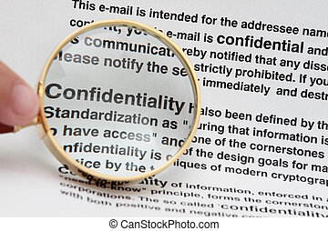 Confidentiality - Words confidential with magnifying a glass...