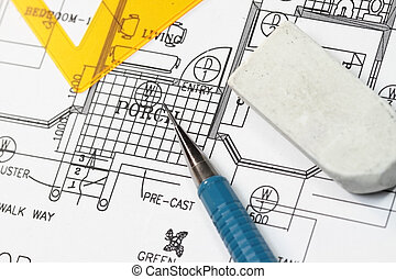 House plan with blueprints and pencil