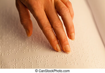 Braille and finger. Book in Braille - Fingers and Braille....