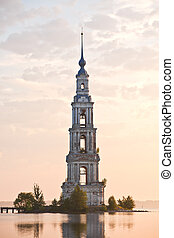 flooded belltower in Kalyazin at sunrise - In 1940s the...