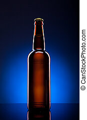 Beer bottle on blue background