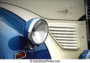 Oldtimer headlight - Headlight of a blue/white oldtimer