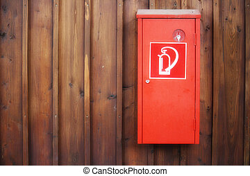 Extinguisher with wood background