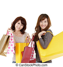 Shopping women, closeup portrait of two lady holding bags...