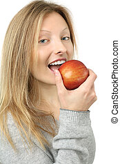 Eating an apple - Photo of a beautiful blond woman holding a...