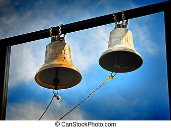 The bells - Two golden bells and blue sky
