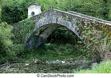 Medieval stone bridge - An old bridge in Lunigiana, Tuscany,...